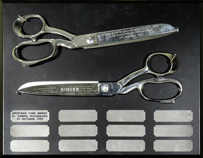 Two ceremonial scissors, inscribed and mounted on board